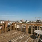 Tuesdays Under 250: Two-Bedroom Riverside Rowhome with a Rooftop Deck and Finished Basement