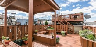 Mid-Week Listing: Approximately 2,500 Sq. Ft. Rowhome in Federal Hill with a Sunroom and Rooftop Terrace