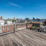 Mid-Week Listing: End-of-Group Rowhome in Locust Point with a Rooftop Deck and Harbor Views